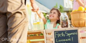 Little girl sells lemonade Country Time Legal-Ade
