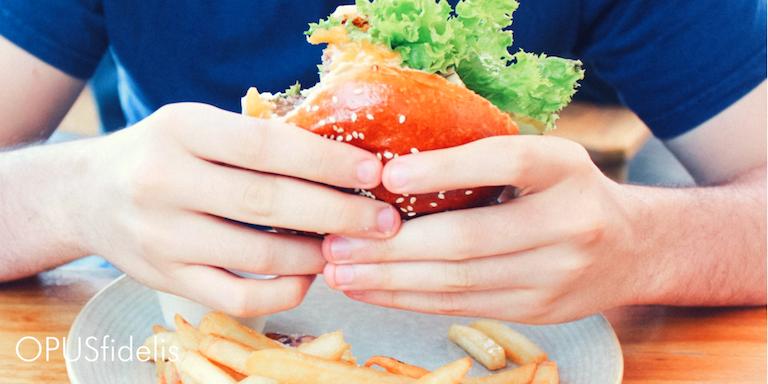 Man eating burger IHOb