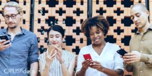 People smiling, on their phones