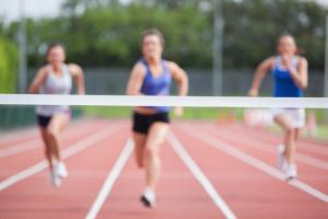 Athletes racing towards finish line