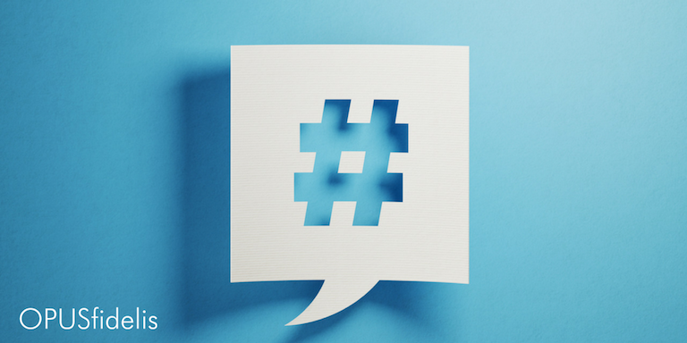 Twitter hashtag in speech bubble against blue background