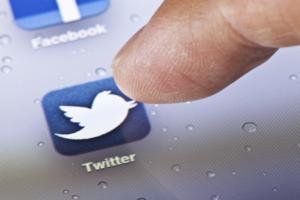 Hong Kong, China - July 23, 2011: Macro image of clicking the Twitter icon on an iPad screen